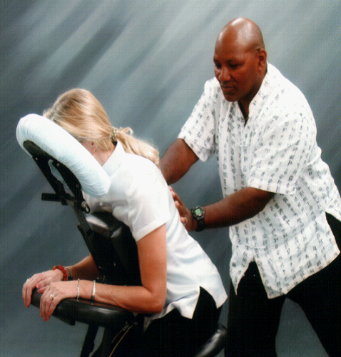 man sitting in the chair got his massage